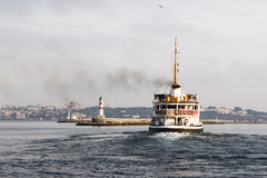 FERRY IN ISTANBUL. A ferry is passing bosphorus from Asia to Europe in Istanbul royalty free stock photos