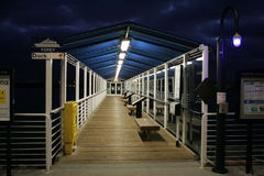Ferry Jetty at Night. Wooden jetty walkway to the Oakland ferry dock in San Francisco, USA. Jetty shown at night stock photo