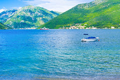 The ferry in Kotor bay. The scenic coast of the Kotor bay with the ferry on the background, Montenegro Stock Photography