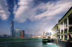 Ferry leave the dock Victoria Harbor in Hong Kong Royalty Free Stock Photography