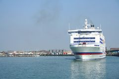 A ferry leaves port. A car ferry leaves Portsmouth harbour for France Royalty Free Stock Image