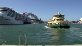 Ferry leaving Circular Quay with a big cruise ship and harbour bridge at the background stock video footage
