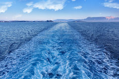 Ferry leaving Corfu island - leaving a trail Stock Photography
