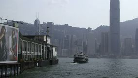 Ferry leaving the harbor in Hong Kong. Ferry leaving harbor in Hong Kong stock footage