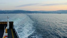 Ferry is leaving the mainland with blue sea. Ferry trail stock video