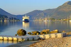 Ferry leaving Nidri harbor,Greece Stock Image
