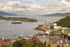 Ferry leaving Oban. A ferry departs from Oban, taking passengers to some of the Scottish Islands Stock Image