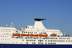 Ferry and lifeboats. Side of ferry showing orange lifeboats royalty free stock photo