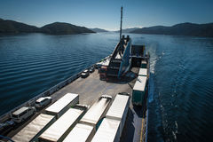 Ferry loaded with trucks and cars traveling from Wellington to Picton via Marlborough Sounds, New Zealand Royalty Free Stock Photography