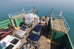 Ferry with loading platform and cars, cars are loaded with cans Stock Photography