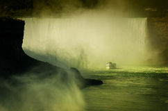 Ferry Maid of the Mist in the Niagara River. Niagara Falls. Ferry Maid of the Mist in the Niagara River against Horseshoe waterfall. Niagara Falls. Aerial view Royalty Free Stock Images