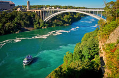 Ferry Maid of the Mist and Rainbow Bridge. Niagara Falls. Niagara Falls, USA - September 24, 2016: Ferry Maid of the Mist and Rainbow Bridge. Niagara River Royalty Free Stock Photography