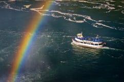 Ferry Maid of the Mist and rainbow in the Niagara River. Niagara Falls. Niagara Falls, USA - September 25, 2016: Ferry Maid of the Mist and rainbow in the Stock Images