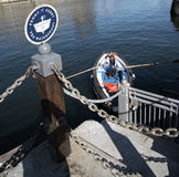 Ferry with man using oars to row Stock Photography