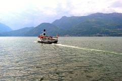 Ferry Milano transporting passangers to Menaggio on lake Como. Stock Photo
