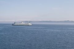 Ferry through the mist. Stock Image