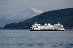 Ferry with Mt. Baker on a background royalty free stock images