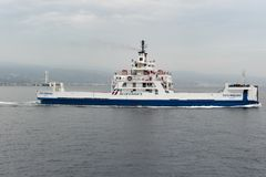 Blueferries. Ferry in navigation on the strait. Bluferries is a company belonging to the Ferrovie dello Stato Italiane group that deals with the ferrying of royalty free stock photo