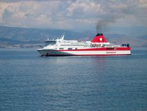 Ferry near Corfu. Red and white ferry near Corfu royalty free stock photo