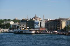 Ferry near Galata Bridge and the Golden Horn, with Hagia Sophia, in Istanbul, Turkey stock photos