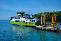 Ferry near the pier in the port Padang Bay, Bali Stock Photography
