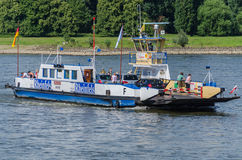 Ferry. Orsoy, Nrw,  Germany - June 09, 2014:  Ferry City Orsoy on the Rhine. The ferry connects Orsoy in NRW, the city of Duisburg Walsum. Some passengers on the Stock Photos