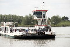 Ferry over river Waal near Brakel stock photography