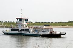 Ferry over river Waal stock photography