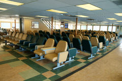 Ferry passenger cabin seating. Seattle, WA, USA Feb. 11, 2017: Passenger seating area on ferry boat crossing Puget Sound from Bainbridge Island to Seattle Royalty Free Stock Image
