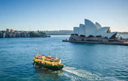 Ferry passes in front of the Sidney Opera House Stock Images