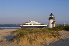 Ferry Passes By Lighthouse on Nantucket Island Royalty Free Stock Photography