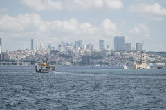 Ferry passes The Maiden`s Tower on sea in Istanbul, Turkey Royalty Free Stock Photos