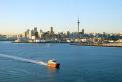 Ferry passing by Auckland Harbor Royalty Free Stock Images