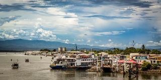Ferry pier in the city of Puntarenas, Costa Rica. Fly in a Hang gliding in Dominical beach, Costa Rica. 2015 royalty free stock photography