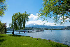 Ferry port at Lucern park which there is mountain as background. Royalty Free Stock Images