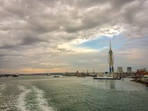 Ferry, Portsmouth Harbour, United Kingdom. Leaving Portsmouth Harbour on a ferry with a ferry and aircraft carrier in the picture royalty free stock images