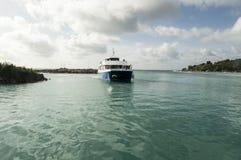 Ferry Praslin to La Digue Island, Seychelles. La Digue, Seychelles - August 12, 2015: Ferry in the turquoise water Stock Photography