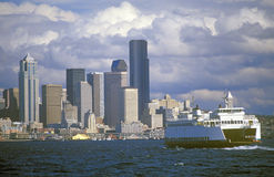 Ferry on Puget Sound with Seattle skyline in background, WA Stock Photos