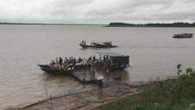 Ferry, rain, cloudy, mekong, cambodia stock footage