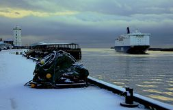 A ship comes in to port in Winter stock images