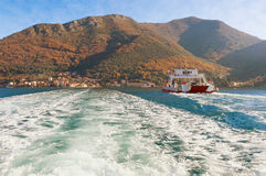 Ferry runs across the narrowest part of the Bay of Kotor. Montenegro royalty free stock photos