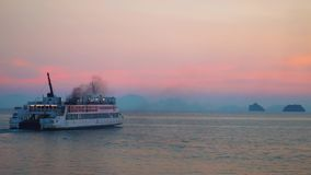 Ferry Sail Across Tropical Sea at Sunset. Shot with a Sony a6300 fps29,97 4k stock footage