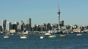 Ferry sail under Auckland downtown skyline Stock Images