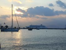 Ferry and Sailboat in Greek harbor Stock Photo