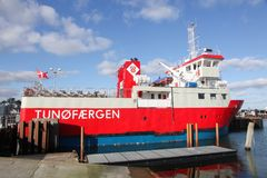 The ferry sailing between the harbor of Hou and the car-free island of Tuno in Denmark. Hou, Denmark - February 26, 2016: The ferry sailing between the harbor of royalty free stock photography