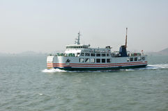 Ferry sailing in the ocean Royalty Free Stock Photo