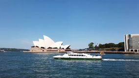 Ferry Sailing Past Sydney Opera House, Australia. Catamaran public transport ferry sailing North out of Circular Quay past the Sydney Opera House, Sydney harbour stock video