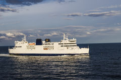 A ferry sailing through the strait Royalty Free Stock Photo