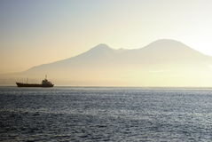 Ferry on a sea with Mount Vesuvius Stock Photography