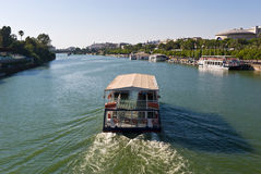 Ferry In Seville. Ferry on the River Guadalquivir in Seville, Spain stock photo